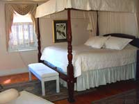 Enjoy a king canopy bed in the Magnolia Suite, spacious Williamsburg lodging